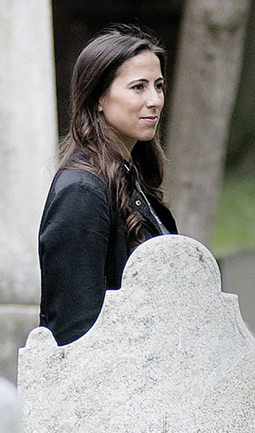 Rachel Zeldin, a board member of the Funeral Consumers Alliance of Greater Philadelphia, an advocacy group, walks through a cemetery behind St. Peter's Church in Philadelphia.
