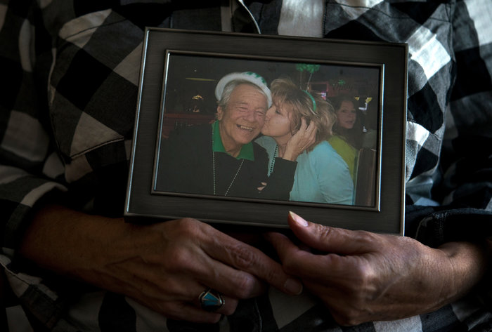 Ellen Bethea holds a picture of herself and her late husband, Archie. Laura Heald for NPR